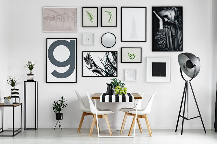 Stylish dining room with artwork on wall