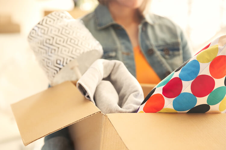 Woman taking out a box of household items