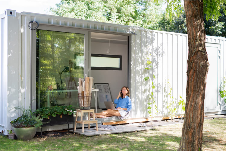 Woman relaxing on a shipping container home