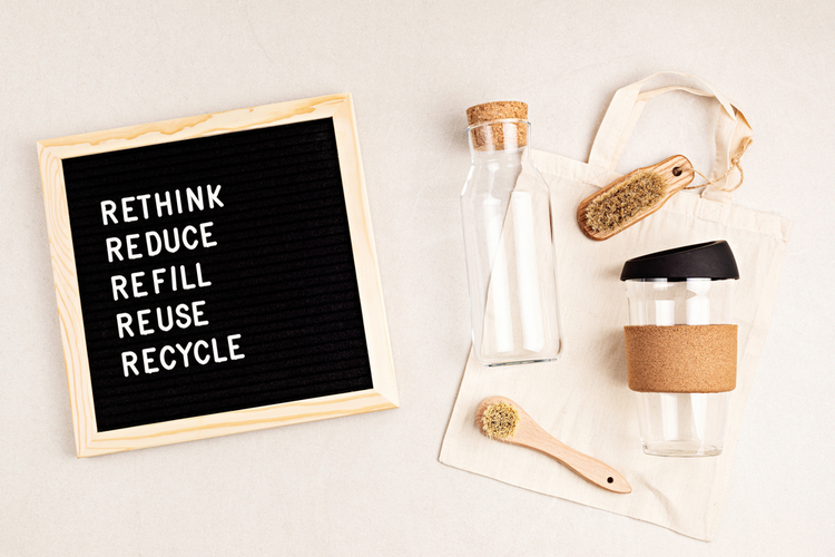 upcycle advice on black board next to reusable items