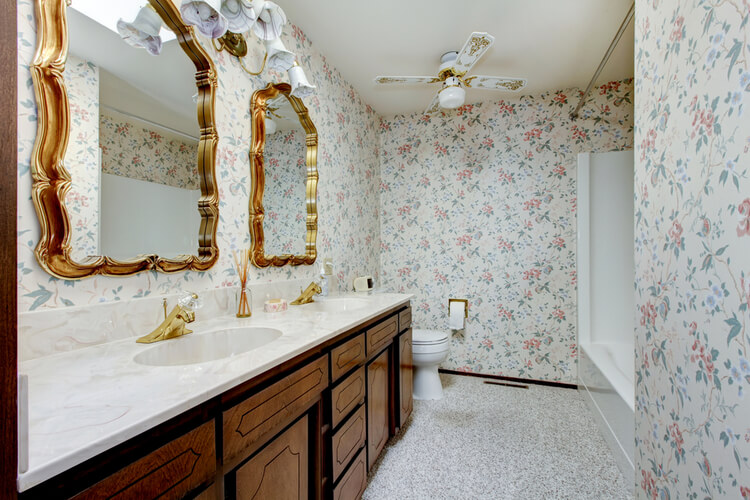 floral wallpaper in french chateau style bathroom