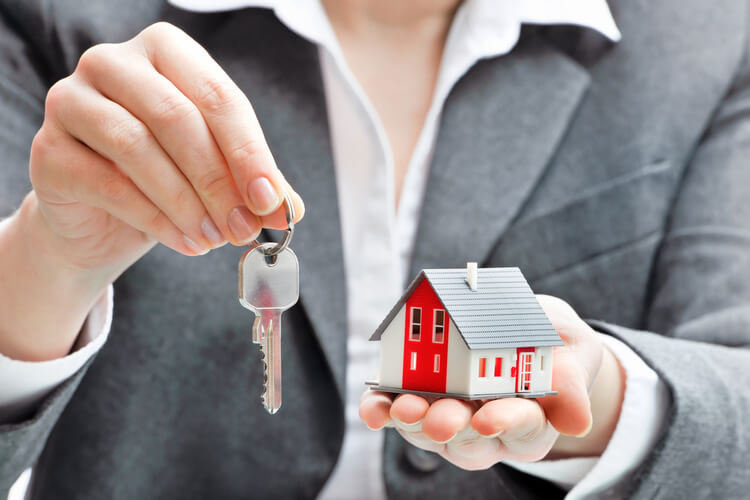 real estate agent handing over keys to house