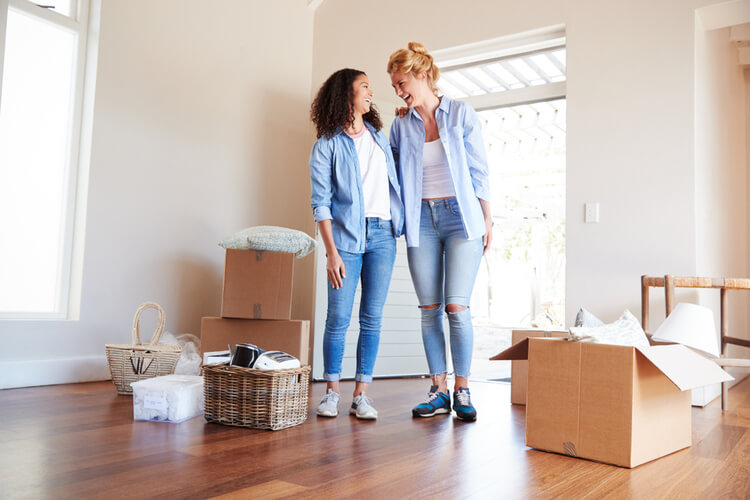 two female friends talking on moving day
